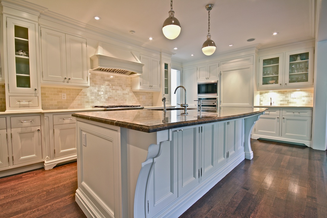 A big kitchen with white cabinets and a marble countertop