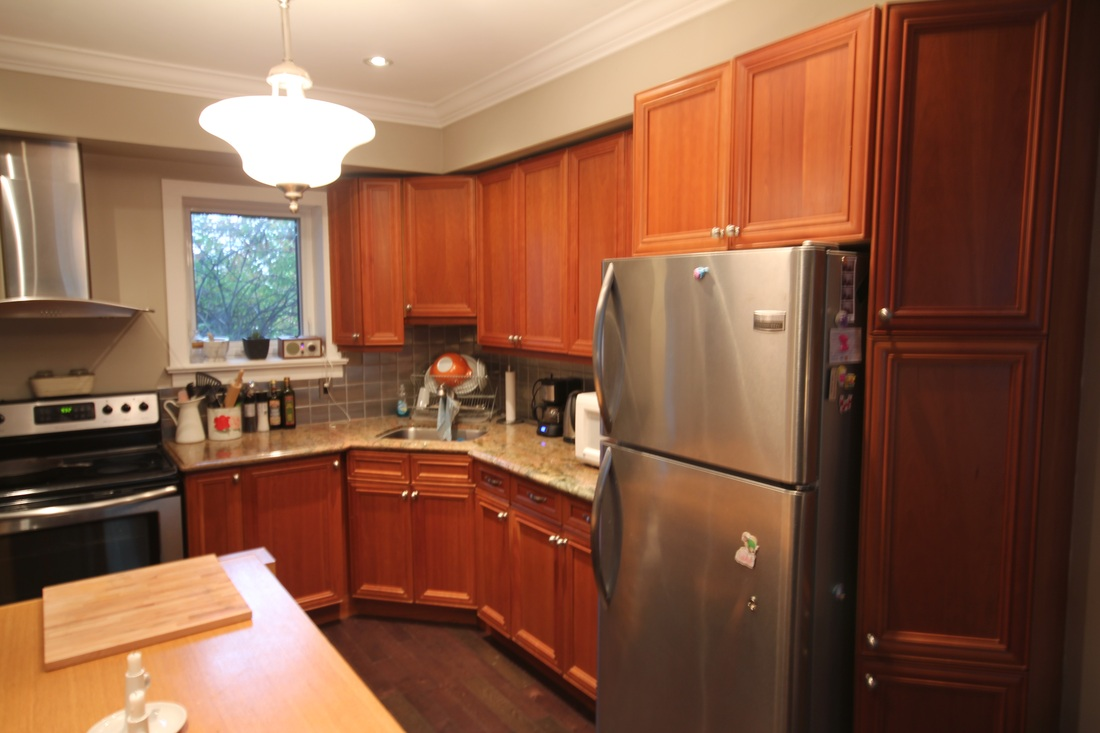 An ordinary kitchen with brown cabinets