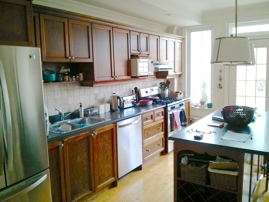 A typical kitchen with a cluttered countertop and sink