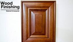 Wood finishing on brown cabinet door